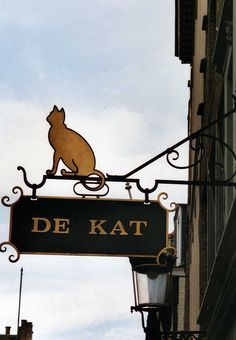 Cat cut out and notched sign -- adorable | De Kat, Magasin Habits, Bruges, Belgium