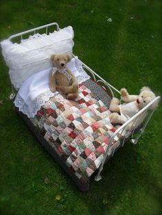 Sweet doll bed ensemble...love the lacey linens too.