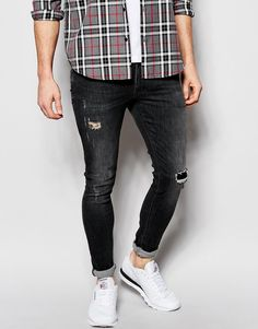$58, Black Ripped Jeans: Asos Brand Extreme Super Skinny Jeans With Rip And Repair. Sold by Asos. Click for more info: https://lookastic.com/men/shop_items/315182/redirect