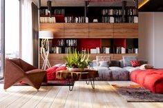 3 Modern Apartment Interiors That Masterfully Demonstrate How To Use Red As An Artistic Accent