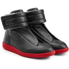 A futuristic silhouette informs these black leather sneakers from Maison Margiela - Black leather, round toe, velcro strap, leather insole and red rubber sole -...