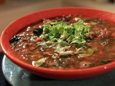 Get this all-star, easy-to-follow Sausage, Kale, and Lentil Soup recipe from Rachael Ray.