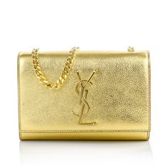 4e0913be3356 Luminous like the sun   super glamouros is the Saint Laurent Monogramme Bag  in Gold.