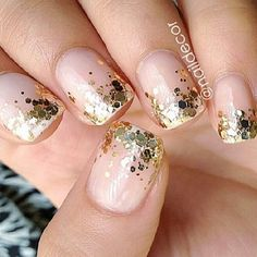 Pale pink with gold glitter nail.
