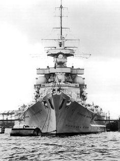 KSM Gneisenau - battleship. Another view of , showing the raked 'Atlantic' bow fitted after she and Scharnhorst were found to be very wet ships in early service.  After reconstruction Scharnhorst's mainmast was shipped further aft than her sister's, making them easy to tell apart.  This famous pair saw much WW2 action and feature prominently below.