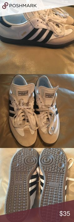 Adidas Samba Shoes Men's Adidas Samba Shoes. White with black stripes along sides. Gold lettering on Samba as pictures near stripes. Tread barely touched - gently worn. Great reviews on this shoe! Adidas Shoes Athletic Shoes