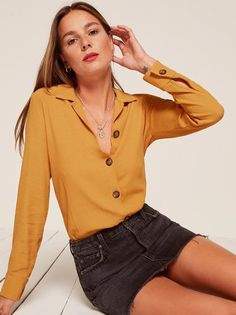 Button up. This is a button front top with notched lapels and a relaxed fit.