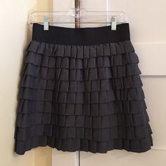 Skirt Gun metal ruffle skirt. With black elastic band. True to size. Versatile and very comfortable. BB Dakota Skirts Mini