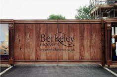 Wood effect construction hoarding. Berkley Homes site entrance hoarding design