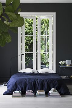 dark bedroom and a navy throw...