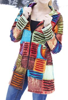 With a patchwork of layered colors and a cozy-warm feel, our long jacket is something special. A hood keeps you all the toastier on cool days. Handmade in Nepal, where colorful clothing is a mark of their vibrant culture.