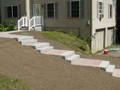 These steps and landings custom walkway make an easy pathway from the driveway to the back yard and patio area on an otherwise steep slope. Description from pinterest.com. I searched for this on bing.com/images