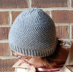 Knit the Spiral Hat and it turned out to slouch much more than this pattern photo. Found pattern via Ravelry.