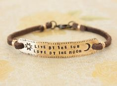 Live by the sun love by the moon, brass leather quote bracelet, sun and moon bracelet, yoga, clasped wrap quote bracelet, yoga jewelry, by ZennedOut on Etsy https://www.etsy.com/listing/227862419/live-by-the-sun-love-by-the-moon-brass