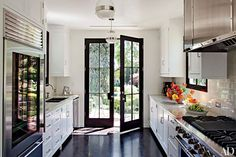 This Madeline Stuart–designed kitchen in Los Angeles is equipped with pendant lights from BK Antiques, a Sub-Zero refrigerator, and a Viking range.