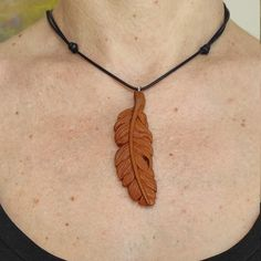 This unique pendant is made of apple tree wood, using hand -non electrical- tools. Painted with natural water based paint and is finished with linseed oil. #Woodcarving #handcarved #featherpendant #woodenfeather #woodenpendant #Skalizo #ChourmouziadisVasileios Gifts For Art Lovers, Lovers Art, Feather Necklaces, Jewelry Necklaces, Wooden Feather, Electrical Tools, Wooden Necklace, Linseed Oil, Apple Tree