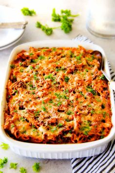 This Million Dollar Baked Penne has been a family favorite for decades! We serve it at all our family gatherings because its SO good, so easy! The homemade sauce is incredible and the hidden layer of creamy/cheesiness is to live for!