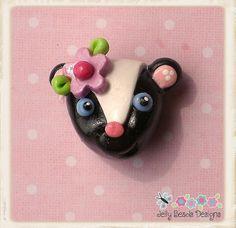 skunk bead, bow center, pendant, charm