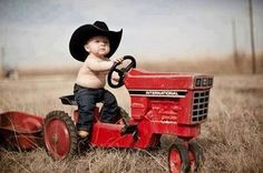 1st Birthday Picture Pose (Baby Sitting on a Pedal Tractor Wearing a Cowboy Hat)