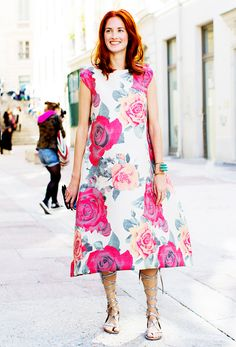 Taylor Tomasi Hill in a bright floral printed dress and metallic gladiator sandals