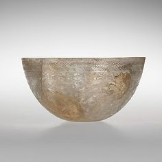 Glass bowl decorated with geometric patterns  Period:     Late Imperial Date:     4th century A.D. Culture:     Roman