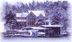 Ozarks Luxury Lake Home - Exterior: Beautiful lake home nestled on the banks of the Lake of the #Ozarks during a snowy winter.  (Home Design & Decor by B.L. Rieke & Associates, Inc.) #luxury #cabin #dreamhome #customhome #homedesign Visit our website: http://www.blrieke.com/ Visit our #Houzz page: http://www.houzz.com/pro/blrieke/