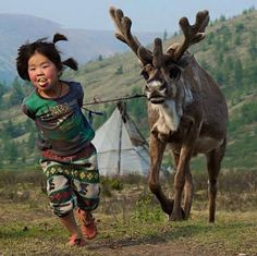 Young girl with reindeer, Mongolia Kids Around The World, We Are The World, People Around The World, Cultures Du Monde, World Cultures, Beautiful Children, Beautiful People, Beautiful Places, Animals For Kids