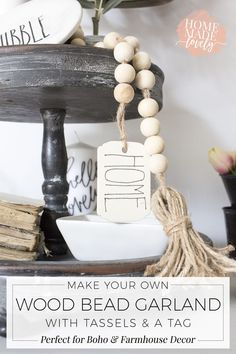 Make your own DIY wood bead garland with tassels and tag for your boho or farmhouse decorated home! The project only takes about 15 minutes!            #diyhomedecor #diycrafts #diyroomdecor #diycraftsforthehome #diycraftsforhome #diycraftstosell #diyfurniturehacks #diyfarmhousestyle #diyfarmhousedecor #farmhousedecoronabudget #farmhousedecordiy #farmhousedecorjoannagaines #farmhousedecorideas