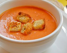Nordstrom's Cafe Tomato Basil Soup: 6 tablespoons olive oil, 4 large carrots peeled and diced, 1 large onion sliced, 1 tablespoon dried basil crushed, 3 28-ounce cans whole peeled Roma tomatoes, 1 quart chicken broth, 1 pint heavy cream, Salt and pepper to taste
