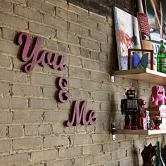 exposed brick with a beautiful set of letters