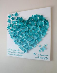 20 x 20 Butterfly Quote Wall Art -Just when the caterpillar thought the world was over, it became a butterfly.  Hundreds of landing butterflies in three gorgeous shades of aqua form this beautiful butterfly heart wall art. Hand painted quote, Just when the caterpillar thought the world was over, it became a butterfly is painted on a high quality stretch artists canvas. Measures 20 x 20.  Also available in 30 x 30.  This item is for decorative purposes ONLY. It is NOT a toy and SHOULD BE…