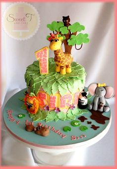 Jungle Cake - This cake was just so fun to make. my kids just loved seeing all the animals come to life. It was soo hard to part with but Im soo happy that the family and Siri absolutely loved it Giraffe Birthday Cakes, Birthday Cake Girls, Giraffe Cakes, Zoo Birthday, Birthday Stuff, Birthday Ideas, Fondant Cupcake Toppers, Cupcake Cakes, Kid Cakes