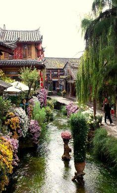 UNESCO sitio de Patrimonio Mundial. Ciudad vieja de Lijiang, CHINA - La Ciudad vieja de Lijiang en la provincia de Yunnan, en China, en el centro de la región histórica de asentamiento de la minoría naxi. Es un barrio de la actual ciudad de Lijiang.