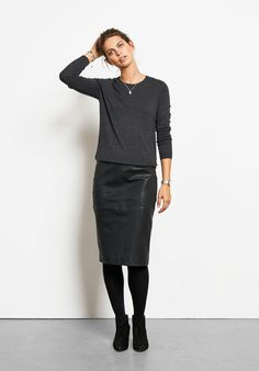 """This beautifully soft leather pencil skirt is an investment piece for seasons to come. Wear it with your favourite jumper and ankle boots for a chic autumn look. • Midi length skirt that sits just on or below the knee depending on height. Tailored skirt with plenty of stretch. • Panelled with a back split. • Exposed back zip. • Centre back length 65.2 cm (size 10) • Model is 5'9"""" and wears size 10."""
