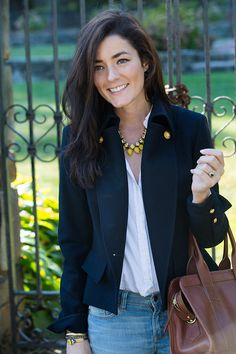 Sarah Vickers in a GANT shirt, J.CREW jeans, LOREN HOPE necklace, PAUW jacket, and FRANK CLEGG bag.