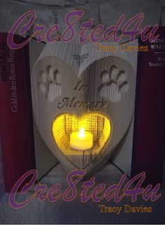 Animal Pet Paw memorial heart with recess for Battery tealight or photo combi book folding pattern Book Folding Patterns, Pattern Books, Dog Photo Frames, Cut And Fold Books, Magazine Crafts, Folded Book Art, Book Sculpture, Pet Paws, Any Book