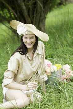 """Gold Swoop Hat. Made of sinamay and paradisal straw, hand blocked and  finished in Nashville. Trimmed with handmade, silk flowers. Pictured with  Olivia Short White and Andrea Blouse Metallic by Cavanagh Baker      * Size 22.5""""     * Made and ready to ship"""