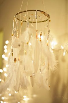 Dreamcatcher chandelier with feathers. I could see this being done with a mini hula hoop. :)