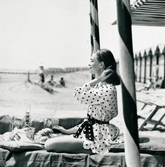 On holiday, Vogue, 1956