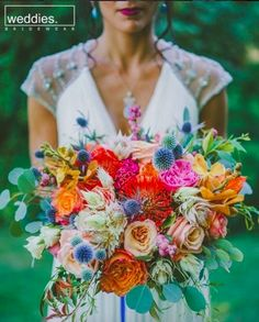 colorful tropical bouquet photo by Brian Evans graphy eclectic wedding in palm springs weddingbouquet bouquets Tropical Wedding Bouquets, Fall Wedding Bouquets, Floral Wedding, Wedding Bridesmaids, Spring Bouquet, Spring Weddings, Bridal Bouquets, Wild Flower Wedding, Summer Wedding Flowers