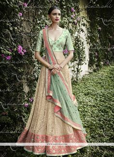 Its a master piece in its class glorifying your timeless beauty. Looking amazing with attachment of cream and sea green net a line lehenga choli. This attire is encrafted with embroidered and resham w...