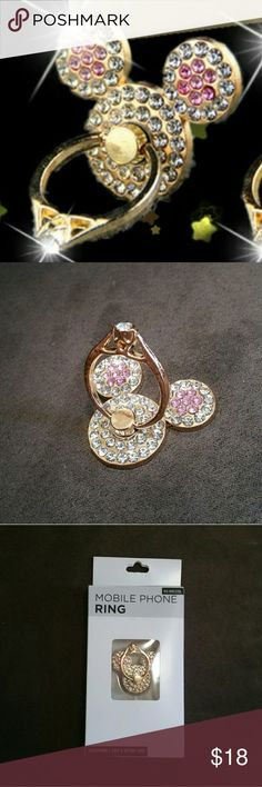 "Cellphone holder ring ""mickey mouse"" jewelled CELL PHONE HOLDER RING     TOTALLY GLAM GOLD MICKEY MOUSE HEAD !!    THIS GORGEOUS RING ATTACHES TO THE BACK OF YOUR CELL PHONE SO IT'S EASY HOLD IT AND LOOK SUPER CUTE WHILE DOING IT !!     Other cell phone holder rings available  Look in my closet for the other listings :) Accessories"