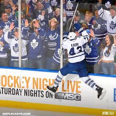 goes for the double high five through the boards. World Photography Day, Toronto Maple Leafs, High Five, Hockey, Baseball Cards, Sports, Boards, Twitter, Give Me 5