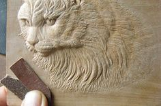 Welcome to my masterclass on artistic relief woodcarving. This method will also allow medal carvers to develop their medal models, coins and various souvenirs using their low relief carving skills. This particular carving of mine is called 'white cat'. T