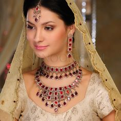 BRI/1/2553 Jilpa Bridal Set includes Necklace, Choker, Earrings, and Maang Tika in silver victorian finish studded with garnet and champaign czee stones  $798 £471