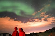 Becky Paguia and me watching the Northern Lights in Iceland (photo by John Fox)