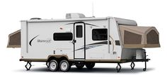 Our new camping trailer, a Forest River Shamrock 21SS. Remind us to never attend another RV show.  We couldn't help it... it's got the CUTEST potty.  At least it's not a toy hauler.  That would be going too far.