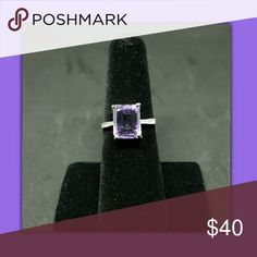4CTTW Genuine Amethyst set in 925 sterling SIZE 6 Beautiful emerald cut genuine amethyst set in sterling silver. Makes a great gift. February birthstone. New in package Jewelry Rings