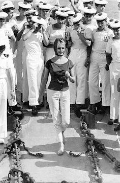 Brigitte Bardot with sailors in St. Tropez, 1958