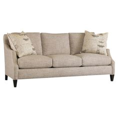 Bring classic style to your living room or den with this streamlined sofa, showcasing stone-hued upholstery and tapered legs.  Produ...